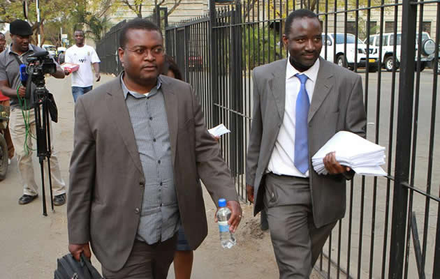 Dr Alex Magaisa (adviser to MDC president Morgan Tsvangirai) and lawyer Chris Mhike going entering the courts