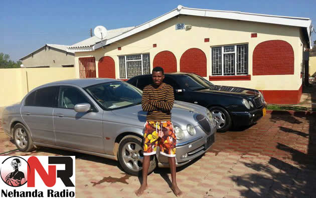 Peter Moyo at home with his cars