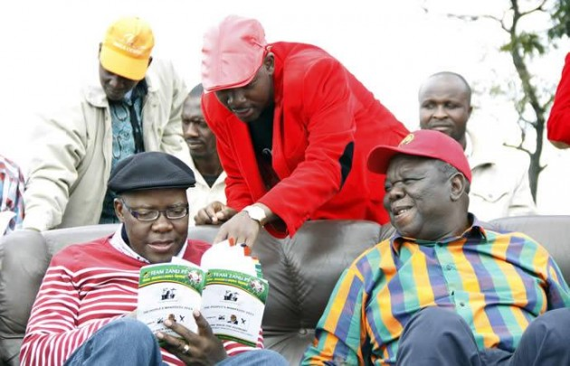 The MDC Trinity: Tendai Biti, Nelson Chamisa and Morgan Tsvangirai laughing at the contents of the Zanu PF Election Manifesto