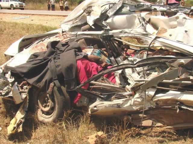 The wreckage of the Toyota Corolla in which seven family members perished in Gweru yesterday