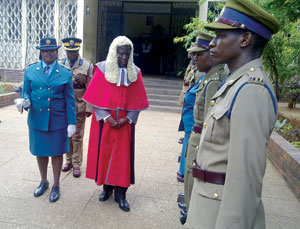 High Court judge Justice Lawrence Kamocha inspects the ZRP Quarter Guard at the opening ceremony of the Gweru High Court circuit