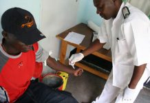A nurse in Zimbabwe attends to a patient (file photo)