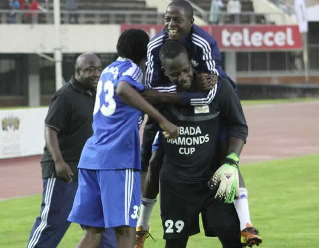 BOUNDLESS JOY . . . How Mine's veteran goalkeeper Ephraim Mazarura (centre) is joined by his teammates and officials in celebrating their victory over CAPS United after a penalty shoot-out during yesterday's Mbada Diamonds Cup semi-final match at the National Sports Stadium