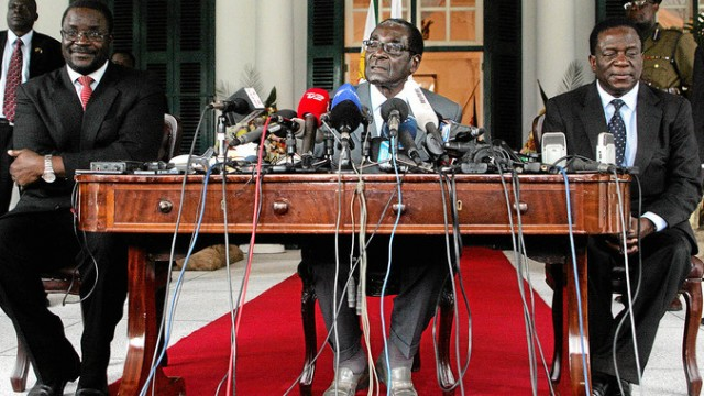 George Charamba (believed to be Nathaniel Manheru with President Robert Mugabe and Justice Minister Emmerson Mnangagwa at a press conference