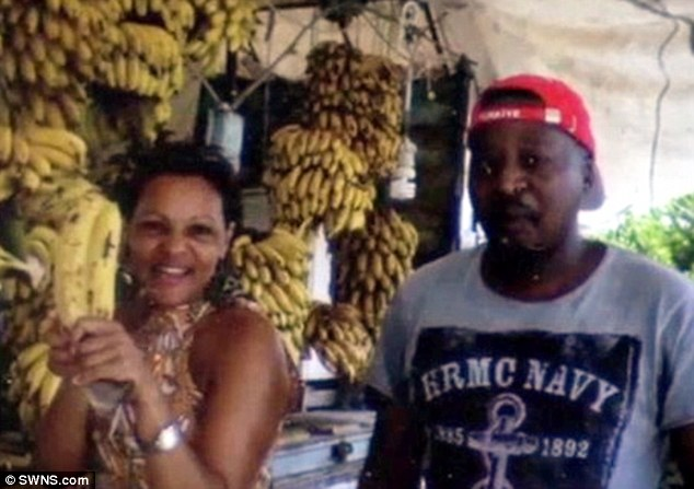Alleged con: Michael Banana with his benefit cheat wife Caroline Banana in a picture taken on holiday. He is now accused of receiving cash for a council house but living elsewhere with her