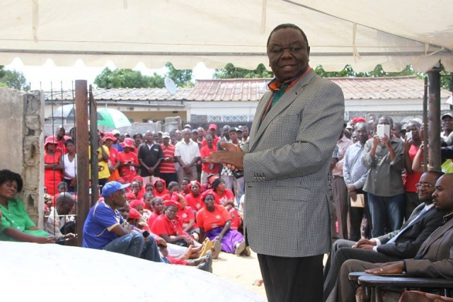 Tsvangirai addressing mourners during the burial of his chief of security Benson Muchineuta