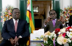 Tsvangirai seen here with Mugabe