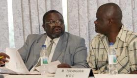 Chris Mbanga (L) and Morgan Komichi (R) are pictured at the verification room at a Harare hotel May 1, 2008 (AFP/File, Alexander Joe)