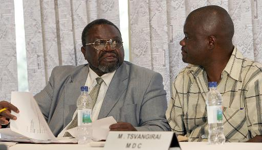Chris Mbanga (L) and Morgan Komichi (R) are pictured at the verification room at a Harare hotel May 1, 2008 (AFP/File, Alexander Joe)