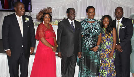 President Mugabe And First Lady Grace Pose For A Photograph With Former Reserve Bank Of