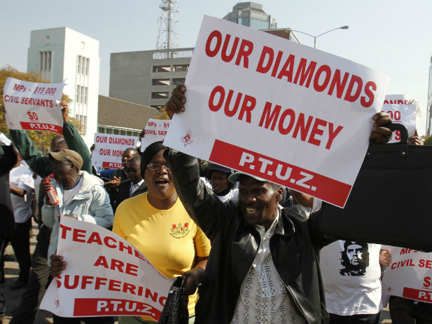 Teachers make their point during a protest for better wages