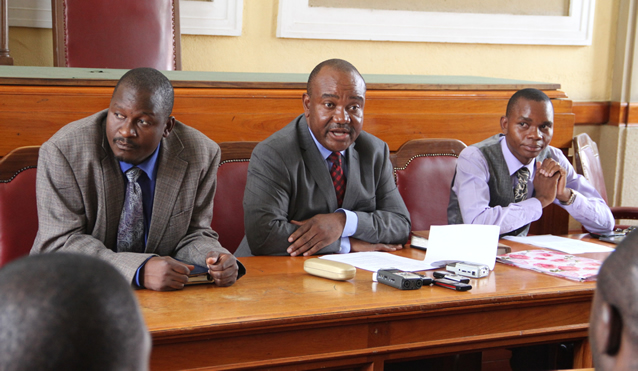 Harare Mayor Bernard Manyenyeni flanked by his deputy Thomas Muzuva and Councilor Wellington Chikomo at Town House in Harare