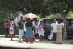 People outside the Western Commonage Magistrates' Court in Bulawayo