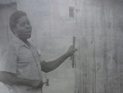 Tichaona fixing the door he removed
