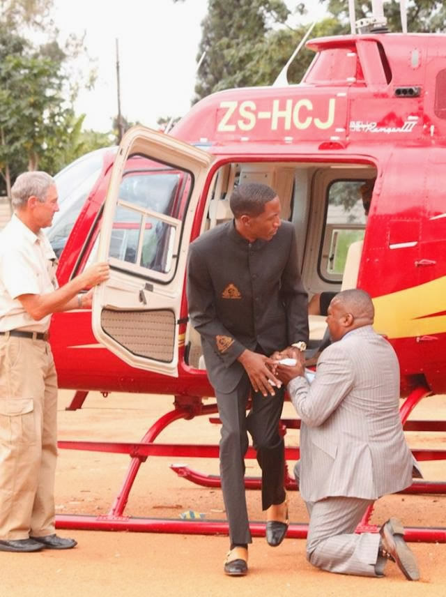 Prophet Angel flew into the year 2014 in a helicopter as he landed at the City Sports Centre to lead his thousands of followers into the New Year