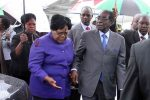 Zimbabwean President Robert Mugabe (R) is greeted by the then Vice President Joice Mujuru (L) as he returns home to Harare, April 12, 2012, after a trip to Singapore that had ignited speculation the veteran leader was seriously ill