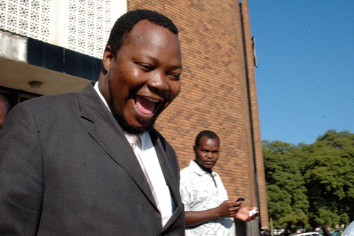 Job Sikhala shares a smile as he emerges from the Harare Magistrates Court