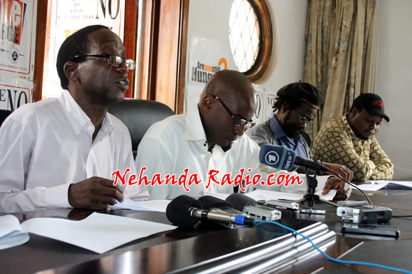 Professor Lovemore Madhuku (left) with Munyaradzi Gwisai (second from right) and Job Sikhala (right) addressing a press conference in March last year