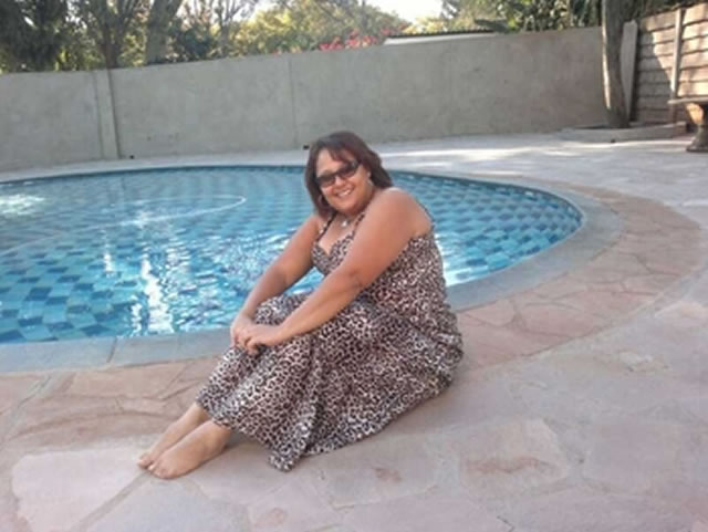 Shamila Roopen, arrested for human trafficking, seen relaxing at her house in Harare