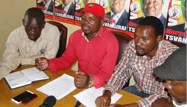MDC-T Bulawayo youth chairperson Bekithemba Nyathi addresses journalists while Ward 9 Councillor Charles Ndlovu (left) and Kunashe Muchemwa follow proceedings