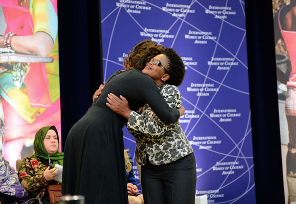 Beatrice (NE) United States  city photos gallery : United States First Lady Michelle Obama embraces 2014 IWOC Awardee ...