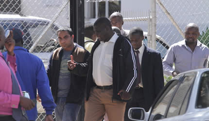 Prominent Mutare lawyer Chris Ndlovu and businessman Mudassar Khan being escorted to court by CID details on Wednesday