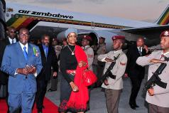Robert Mugabe and his wife Grace using an Air Zimbabwe plane on a trip to South Africa (file photo)