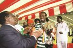 THE CUP IS MINE . . . .FC Platinum skipper Thabani Kamusoko holds the Independence Cup as he soaks in the applause from Senior Minister of State Simon Khaya Moyo (left) and Sport, Arts and Culture Minister Andrew Langa at the National Sports Stadium yesterday