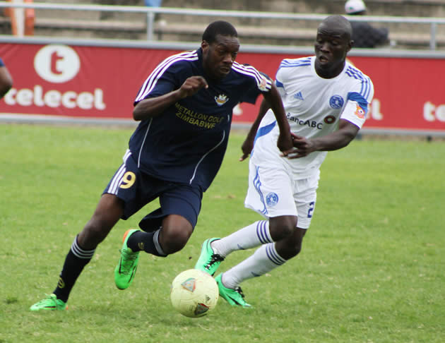 How Mine striker Kuda Musharu (left) fights for the ball with Dynamos centre-back Temba Ndlovu during their Premiership tie at Barbourfields