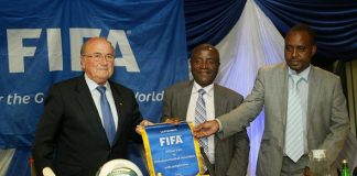 Sepp Blatter the FIFA President presents a commemorative plaque to the President of the Zimbabwe Football Association Cuthbert Dube (C) as the ZIFA Chief Executive Officer Jonathan Mashingaidze (R) watches in Harare on July 4, 2011