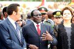 Zimbabwe President Robert Mugabe chats to Botswana President Ian Khama