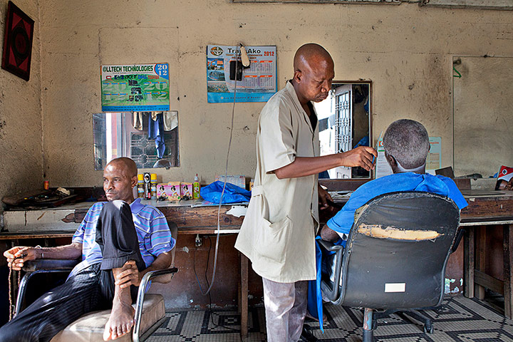 men in barber shop in Africa