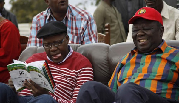 Taking a leaf from the Zanu PF manifesto: Tendai Biti seen here with Morgan Tsvangirai