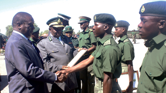 Justice, Legal and Parliamentary Affairs minister Emmerson Mnangagwa shakes hands with a Zimbabwe Prison Services officer who graduated at Ntabazinduna (Picture: Southern Eye)