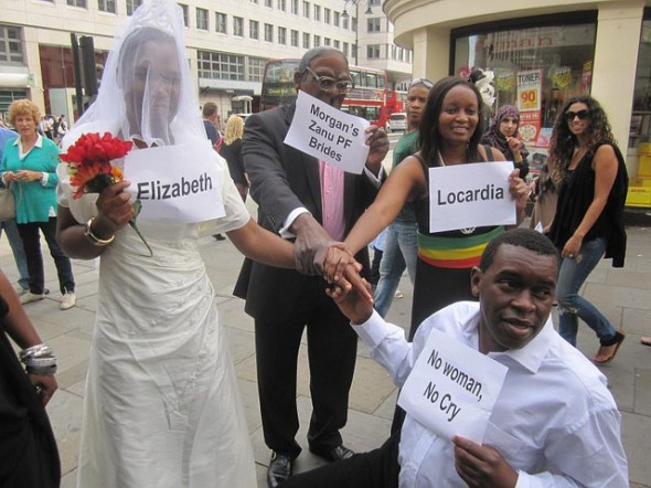 "Zimbabwe Vigil mock wedding featuring Philip Maponga and Lindiwe Bare in September 2012: ""Mugabe gives the Zanu PF brides to Tsvangirai"" Zimbabwe Vigil"