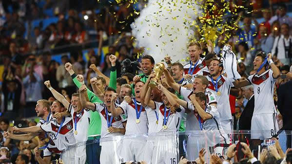 Champions: Philipp Lahm of Germany lifts the World Cup trophy after defeating Argentina 1-0 in extra time