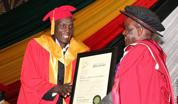 Tuku receives his degree certificate from Professor Boniface Chibore (Picture by Zimbo Jam)