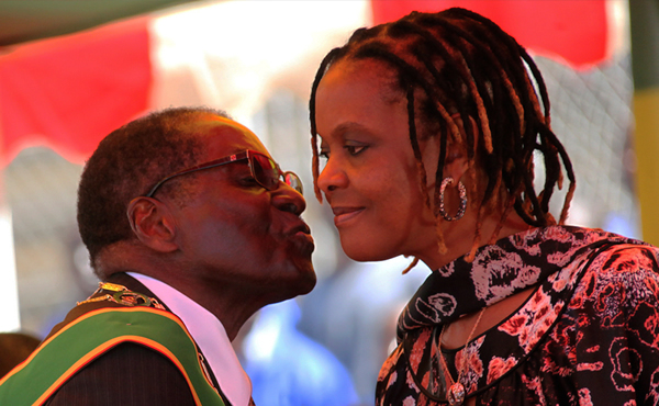 President Mugabe kisses his wife Grace Mugabe. The First Lady used to be Mugabe's 'Small House' before they married.