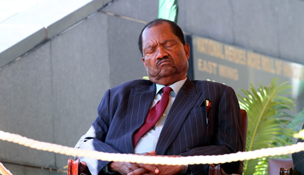 Zanu PF Information Secretary Rugare Gumbo sleeps through the proceedings during the burial of Elias Kanengoni at the National Heroes Acre