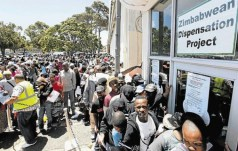 Zimbabweans stand in a long queue at a Home Affairs office in SA when a deportation deadline loomed. File photo. Image by: ESA ALEXANDER