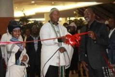 Chief Mandela, flanked by his wife Nkosikazi Mbalenhle Makathini and businessman Shingi Mutasa, officially opens GotchaNyama Restaurant in Harare last Friday