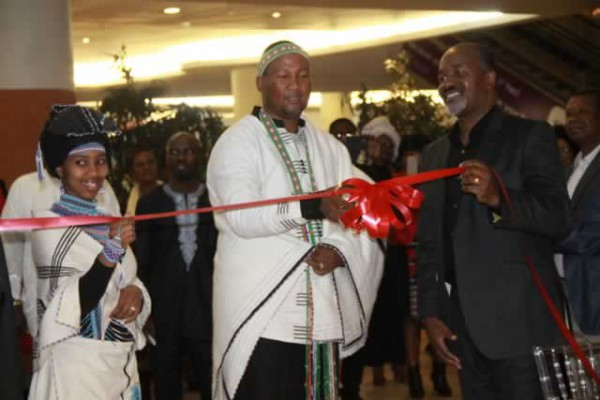 Chief Mandela, flanked by his wife Nkosikazi Mbalenhle Makathini and businessman Shingi Mutasa, officially opens GotchaNyama Restaurant in Harare last Friday