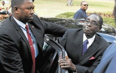 President Robert Mugabe arrives at the Joaquim Chissano International Conference Centre in Maputo, Mozambique