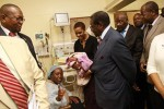 President Mugabe and the First Lady Amai Grace Mugabe talk to the mother of the separated conjoined twins Agnes Mangoro (centre) while Health and Child Care Minister Dr David Parirenyatwa, head of the surgical team MR Bothwell Mbuwayesango and the board chairman of Harare Central Hospital Dr Douglas Gwatidzo look on at Harare Children's Hospital yesterday