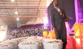 United Family International Church leader Prophet Emmanuel Makandiwa stands next to the anointing oil which he launched in Chitungwiza yesterday. — (Picture by Munyaradzi Chamalimba)