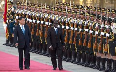 Chinese President Xi Jinping, left, walks with Zimbabwe's President Robert Mugabe during a welcome ceremony outside the Great Hall of the People in Beijing, China Photo: AP
