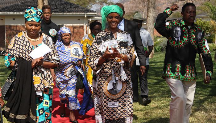 """Oppah Muchinguri (left) seen here with Grace Mugabe (centre) and Zanu PF """"Youth"""" Chairman Absolom Sikhosana"""
