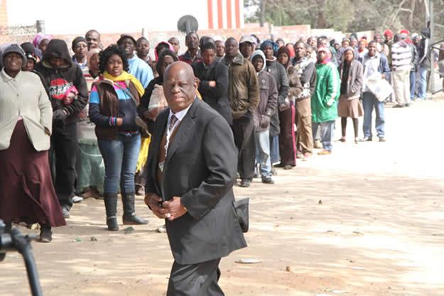 ZANU PF Makokoba constituency retired colonel Tshinga Dube arrive at Stanely Hall polling station after voting in Makokoba Bulawayo