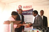 Acting President Joice Mujuru hands over a certificate of achievement to Professor Collins Masimirembwa during the official opening of AIBST DNA Laboratory at Wilkins Hospital in Harare yesterday, while Health and Child Care Minister David Parirenyatwa looks on. — (Picture by Tawanda Mudimu)