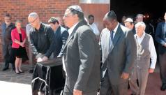 Friends to the Grave: Former RBZ Governor Dr Gideon Gono (wearing a black Jewish cap) was a pallbearer at Dr Eric Bloch's funeral (Picture by The Chronicle)